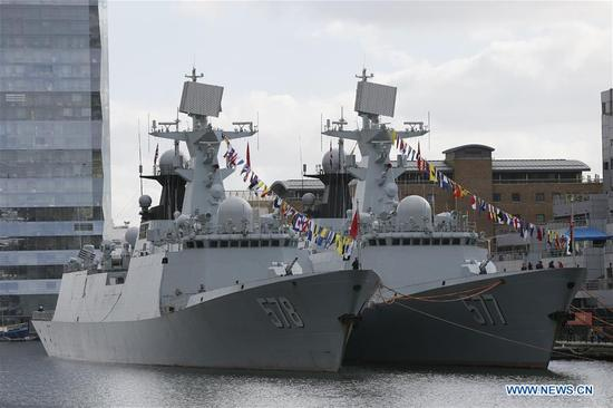 Chinese naval guided-missile frigates Huanggang (R) and Yangzhou are seen in London, Britain, on Oct. 3, 2017. China's 26th naval escort fleet arrived here Tuesday for a five-day friendly visit to Britain. This is the first time for Chinese naval ships to pay an official visit to the British capital city. (Xinhua/Tim Ireland)