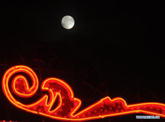 Photo taken on Oct. 4, 2017 shows the moon during the Mid-Autumn Festival in Suzhou, east China's Jiangsu Province. The Mid-Autumn Festival, the 15th day of the eighth month on China's lunar calendar, is an occasion for family gatherings. (Xinhua/Hang Xingwei)