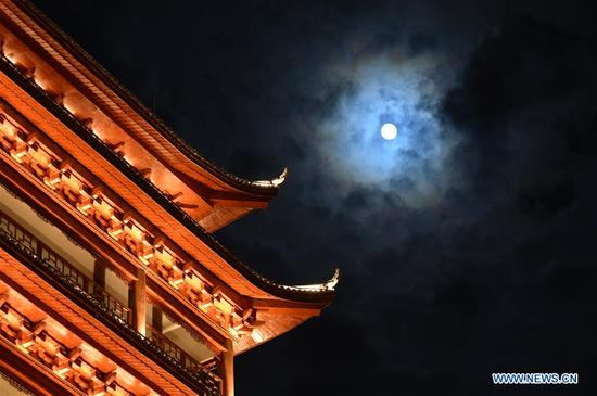 Photo taken on Oct. 4, 2017 shows the moon during the Mid-Autumn Festival in Longli County, southwest China's Guizhou Province. The Mid-Autumn Festival, the 15th day of the eighth month on China's lunar calendar, is an occasion for family gatherings. (Xinhua/Pan Xilai)