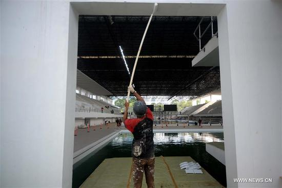 A worker paints the site of the aquatic venue for the 2018 Asian Games in Jakarta, Indonesia, on Oct. 4, 2017. Jakarta and Palembang in Indonesia will host the 2018 Asian Games from Aug. 18 to Sept. 2, 2018. (Xinhua/Agung Kuncahya B.)