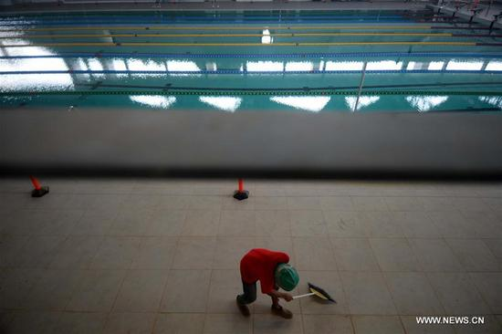 A worker cleans the floor of the aquatic venue for the 2018 Asian Games in Jakarta, Indonesia, on Oct. 4, 2017. Jakarta and Palembang in Indonesia will host the 2018 Asian Games from Aug. 18 to Sept. 2, 2018. (Xinhua/Agung Kuncahya B.)