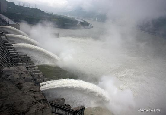 Photo taken on Oct. 5, 2017 shows water discharging from the Three Gorges Dam, a gigantic hydropower project on the Yangtze River, in Yichang City, central China's Hubei Province. (Xinhua/Wen Zhenxiao)