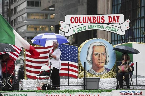 People attend the Columbus Day parade on Manhattan's Fifth Avenue in New York, the United States, on Oct. 9, 2017. Thousands of people participated in the celebration of the Italian American culture and heritage here on Monday. (Xinhua/Wang Ying)