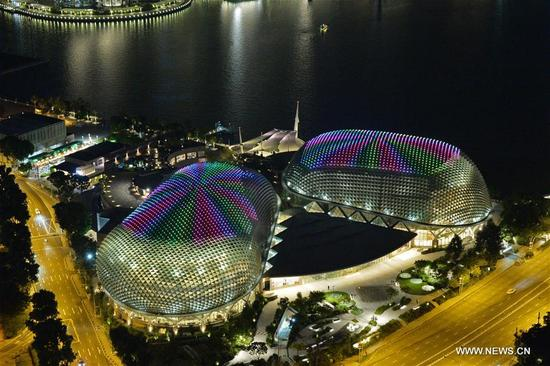 Lights from 2,807 LED form different designs on the twin domes of Singapore's Esplanade on Oct. 10, 2017. Esplanade, Theaters on the Bay, will be projecting the light show from Oct. 12 to 31 as part of its 15th anniversary celebrations. (Xinhua/Then Chih Wey)