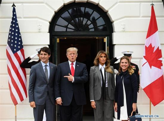 U.S. President Donald Trump (2nd L) welcomes visiting Canadian Prime Minister Justin Trudeau (1st L) at the White House in Washington D.C., the United States, on Oct. 11, 2017. Trump met with Trudeau Wednesday amid new NAFTA negotiations. (Xinhua/Yin Bogu)