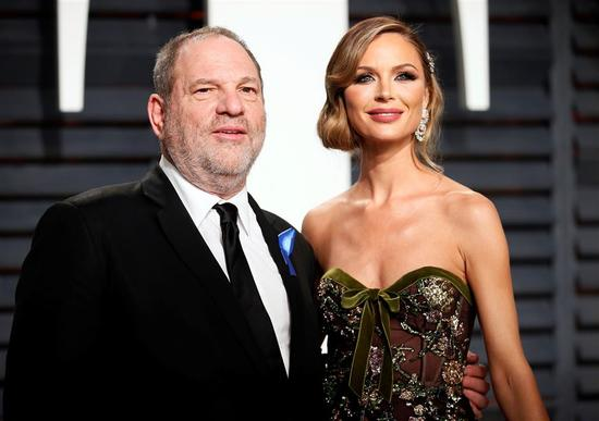 Producer Harvey Weinstein and fashion designer Georgina Chapman at Oscars Vanity Fair Party on February 26, 2017 at Beverly Hills, California, U.S.