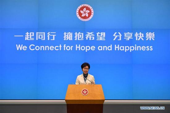 Chief Executive of China's Hong Kong Special Administrative Region Lam Cheng Yuet-ngor attends a press conference after delivering her first policy address since she assumed office on July 1, in Hong Kong, south China, Oct. 11, 2017. (Xinhua/Wang Xi)
