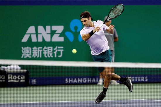Roger Federer of Switzerland in action against Diego Schwartzman of Argentina during their Shanghai Rolex Masters second-round match at the Qizhong Tennis Center in suburban Minhang District on October 11, 2017.