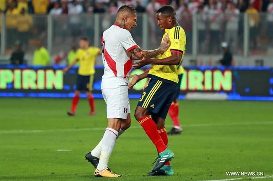 Peru's Paolo Guerrero (L) and Colombia's Oscar Murillo (R) react during the Russia 2018 FIFA World Cup qualifier match, at the National Stadium of Lima, in Lima, Peru, on Oct. 10, 2017. The match ended in a draw 1-1. (Xinhua/Carlos Lezama/ANDINA)