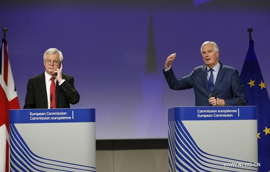 """Britain's Brexit Secretary David Davis (L) and European Union (EU) chief negotiator Michel Barnier attend a press conference at the end of the fifth round of Negotiation on Brexit talks at the EU Commission in Brussels, Belgium, Oct. 12, 2017. The Brexit talks are currently in a """"disturbing deadlock,"""" but no deal between the EU and Britain would be a bad deal, Michel Barnier told reporters Thursday. (Xinhua/Ye Pingfan)"""