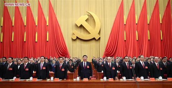 Xi Jinping (C, front), Li Keqiang (3rd R, front), Zhang Dejiang (3rd L, front), Yu Zhengsheng (2nd R, front), Liu Yunshan (2nd L, front), Wang Qishan (1st R, front), Zhang Gaoli (1st L, front), Jiang Zemin (4th R, front) and Hu Jintao (4th L, front) attend the opening session of the 19th National Congress of the Communist Party of China (CPC) at the Great Hall of the People in Beijing, capital of China, Oct. 18, 2017. (Xinhua/Lan Hongguang)