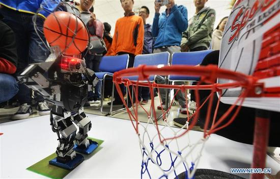 A robot shoots at the basket during a robot competition held at Tianjin Polytechnic University in north China's Tianjin, Oct. 29, 2017. A total of 286 teams from 16 universities participated in the competition on Sunday. (Xinhua/Shi Songyu)