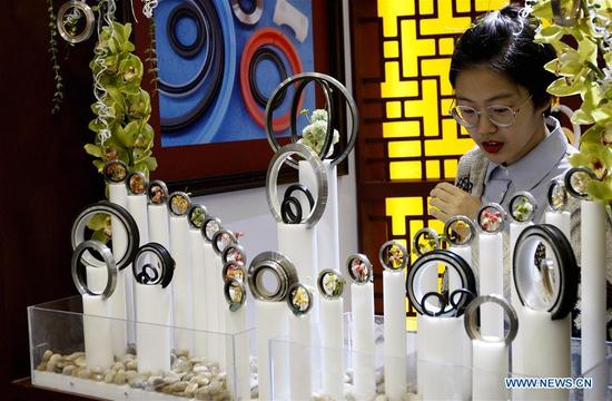 A visitor looks at oil sealing ring products at the 2017 Power Transmission and Control Asia in Shanghai, east China, Oct. 31, 2017. About 2,500 enterprises from home and abroad participated in the event, which focused on intelligent manufacturing this year. (Xinhua/Fang Zhe)