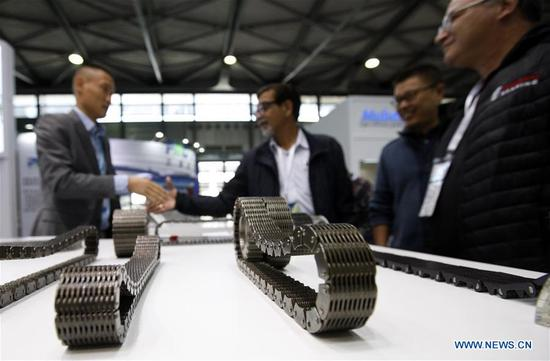 Photo taken on Oct. 31, 2017 shows transmission chain exhibits at the 2017 Power Transmission and Control Asia in Shanghai, east China. About 2,500 enterprises from home and abroad participated in the event, which focused on intelligent manufacturing this year. (Xinhua/Fang Zhe)