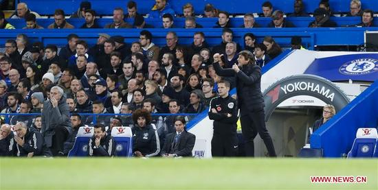 Antonio Conte (R), manager of Chelsea and Jose Mourinho, manager of Manchester United look on during the English Premier League match at Stamford Bridge Stadium in London, Britain on Nov. 5, 2017. Chelsea won 1-0. (Xinhua/Han Yan)