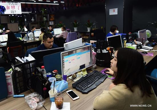 Staff members of an e-commerce company deal with orders of the upcoming Singles' Day shopping spree in Yiwu, east China's Zhejiang Province, Nov. 8, 2017. The e-commerce companies and courier services are busy preparing for the Singles' Day shopping spree which falls on Nov.11. (Xinhua/Gong Xianming)
