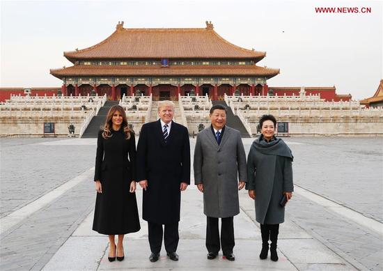 Chinese President Xi Jinping (2nd R) and his wife Peng Liyuan (1st R), and U.S. President Donald Trump (2nd L) and his wife Melania Trump pose for a photo in front of Taihedian, the Hall of Supreme Harmony, during their visit to the Palace Museum, or the Forbidden City, in Beijing, capital of China, Nov. 8, 2017. (Xinhua/Xie Huanchi)