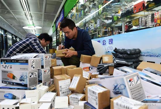 Staff members of an e-commerce company package products in Yiwu, east China's Zhejiang Province, Nov. 8, 2017. The e-commerce companies and courier services are busy preparing for the Singles' Day shopping spree which falls on Nov.11. (Xinhua/Gong Xianming)