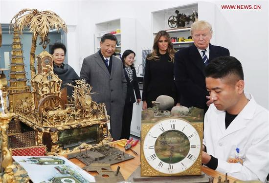 Chinese President Xi Jinping (2nd L) and his wife Peng Liyuan (1st L), and U.S. President Donald Trump (2nd R) and his wife Melania Trump (3rd R) watch the repair of some historical relics at the conservation workshop of the Palace Museum in Beijing, capital of China, Nov. 8, 2017. (Xinhua/Liu Weibing)