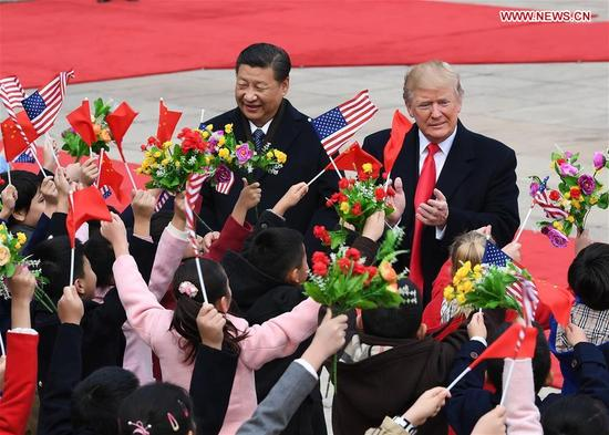Chinese President Xi Jinping (L) holds a grand ceremony to welcome U.S. President Donald Trump at the square outside the east gate of the Great Hall of the People in Beijing, capital of China, Nov. 9, 2017. (Xinhua/Rao Aimin)