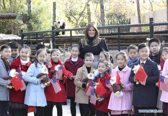 U.S. First Lady Melania Trump poses for a group photo with pupils during her visit to the giant panda enclosure at the Beijing Zoo in Beijing, capital of China, Nov. 10, 2017. (Xinhua/Pang Xinglei)