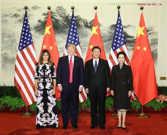 Chinese President Xi Jinping (2nd R) and his wife Peng Liyuan (1st R), and U.S. President Donald Trump (2nd L) and his wife Melania Trump pose for group photos at the Great Hall of the People in Beijing, capital of China, Nov. 9, 2017. Xi held a grand ceremony to welcome Trump on Thursday. (Xinhua/Lan Hongguang)