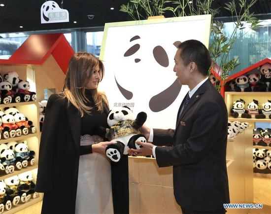 U.S. First Lady Melania Trump (L) receives a giant panda doll during her visit to the giant panda enclosure at the Beijing Zoo in Beijing, capital of China, Nov. 10, 2017. (Xinhua/Pang Xinglei)
