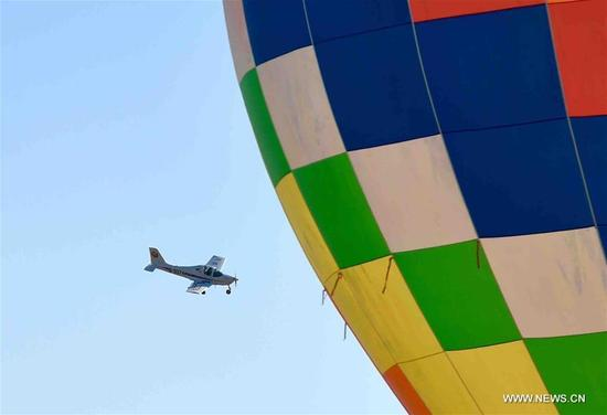 A fixed wing aircraft flies over Douzhuang General Aviation Airport, Binhai District in north China's Tianjin Municipality, Nov. 11, 2017. Tianjin's first aero-sport camp was put into use here on Saturday. (Xinhua/Yue Yuewei)