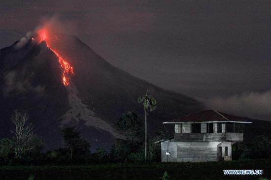 Mount Sinabung spews hot lava and ash in Karo district, North Sumatra province of Indonesia, on Nov. 12, 2017. Mount Sinabung is one of Indonesia's 129 active volcanoes and has been on top alert since July 2, 2015. (Xinhua/Albert Damanik)