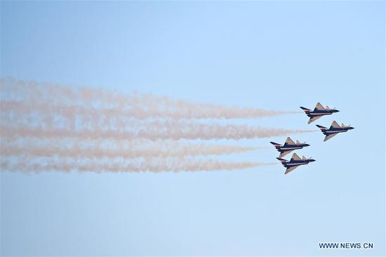 J-10 aerobatic fighter jets of the Chinese Air Force's August 1st Air Demonstration Team perform on the opening day of the Dubai Airshow 2017 in Dubai, the United Arab Emirates, on Nov. 12, 2017. Six J-10 aerobatic fighter jets of the Chinese Air Force's August 1st Air Demonstration Team demonstrated their acrobatic skills for the first time in the history of the Dubai Airshow which started on Sunday in its 15th edition. (Xinhua/Zhao Dingzhe)