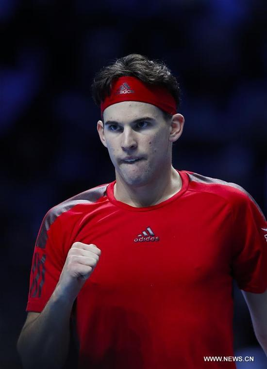 Dominic Thiem of Austria reacts during his group stage match against Grigor Dimitrov of Bulgaria in the ATP World Tour Finals at O2 Arena in London, Britain on Nov. 13, 2017. Dominic Thiem lost 1-2. (Xinhua/Han Yan)