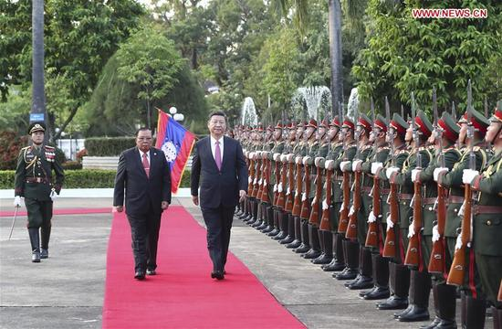 Chinese President Xi Jinping, also general secretary of the Communist Party of China Central Committee, attends a grand welcome ceremony held by Bounnhang Vorachit, general secretary of the Lao People's Revolutionary Party (LPRP) Central Committee and president of Laos, before their talks in Vientiane, Laos, Nov. 13, 2017. (Xinhua/Ma Zhancheng)