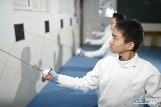Students practice fencing at No. 34 Middle School in Hohhot, capital of north China's Inner Mongolia Autonomous Region, Nov. 13, 2017. (Xinhua/Wang Zheng)