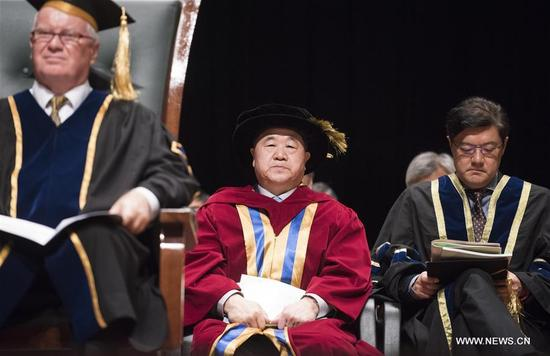 Nobel literature laureate Mo Yan (C) attends the honorary doctoral degree conferment ceremony at Baptist University in Hong Kong, south China, Nov. 13, 2017. Mo Yan was awarded the degree of honorary doctor of letters by the university. (Xinhua/Liu Yun)