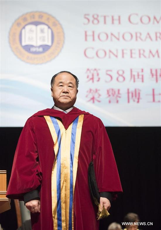 Nobel literature laureate Mo Yan attends the honorary doctoral degree conferment ceremony at Baptist University in Hong Kong, south China, Nov. 13, 2017. Mo Yan was awarded the degree of honorary doctor of letters by the university. (Xinhua/Liu Yun)