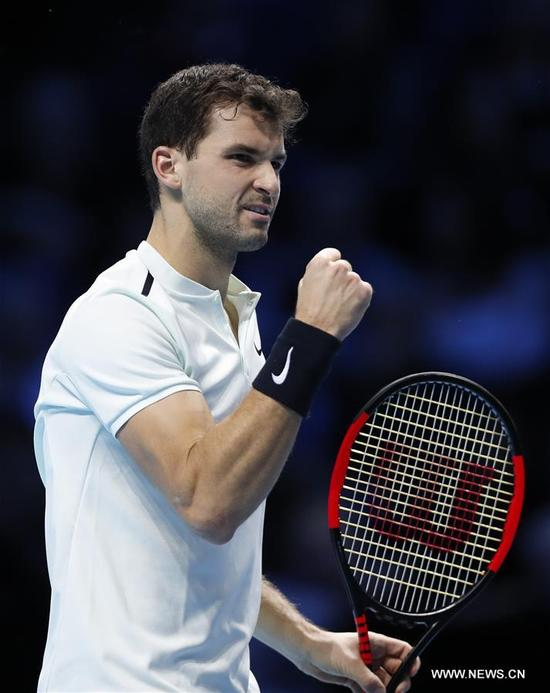Grigor Dimitrov of Bulgaria reacts during his group stage match against Dominic Thiem of Austria in the ATP World Tour Finals at O2 Arena in London, Britain on Nov. 13, 2017. Grigor Dimitrov won 2-1. (Xinhua/Han Yan)