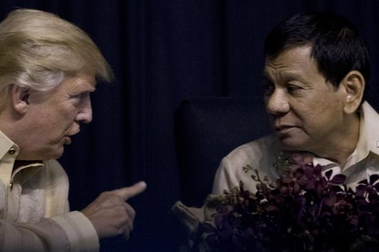 Trump speaks with Philippines President Rodrigo Duterte at an ASEAN Summit dinner at the SMX Convention Center, Sunday, Nov. 12, 2017, in Manila, Philippines.