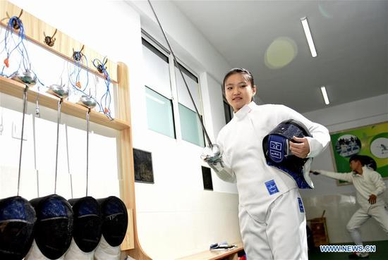 A student prepares to practice fencing at No. 34 Middle School in Hohhot, capital of north China's Inner Mongolia Autonomous Region, Nov. 13, 2017. (Xinhua/Wang Zheng)
