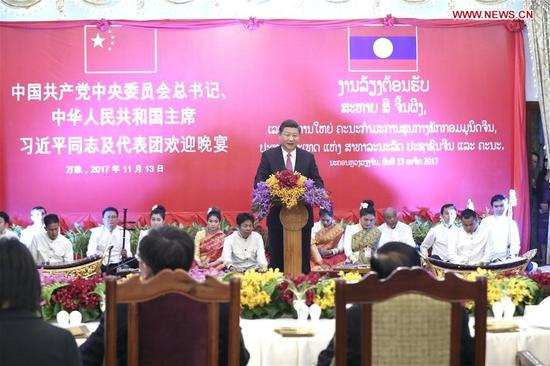 Chinese President Xi Jinping, also general secretary of the Communist Party of China Central Committee, addresses a welcome banquet held by Bounnhang Vorachit, general secretary of the Lao People's Revolutionary Party (LPRP) Central Committee and president of Laos, in Vientiane, Laos, Nov. 13, 2017. (Xinhua/Ma Zhancheng)