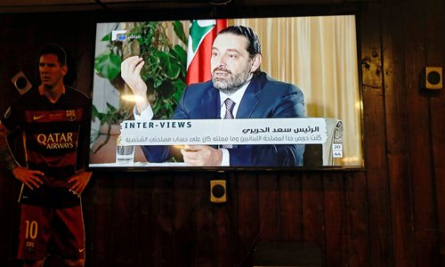 Lebanon's recently resigned prime minister Saad al-Hariri is seen at a Future television interview in Saudi Arabia, at a coffee shop in Beirut, Lebanon on Sunday. Photo: VCG