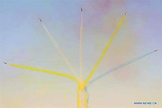Aircraft from Chinese Air Force's August 1st Air Demonstration Team perform during the 15th Dubai Airshow in Dubai, the United Arab Emirates, on Nov. 14, 2017. The 15th Dubai Airshow is held from Nov. 12 to Nov. 16. (Xinhua/Zhang Hao)