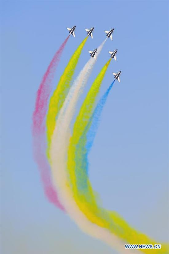 Aircraft from Chinese Air Force's August 1st Air Demonstration Team perform during the 15th Dubai Airshow in Dubai, the United Arab Emirates, on Nov. 14, 2017. The 15th Dubai Airshow is held from Nov. 12 to Nov. 16. (Xinhua/Zhao Dingzhe)