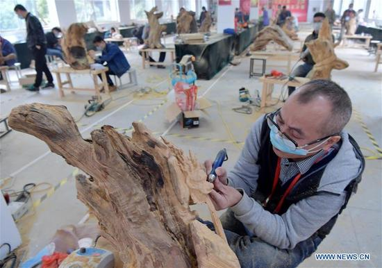 A participant works on a sculpture at the 2017 Chinese skill competition - national carving vocational skill contest final - in Yujiang County, east China's Jiangxi Province, Nov. 13, 2017. A total of 117 people from 11 provinces attended the competition aimed at promoting craftsmanship spirit. (Xinhua/Peng Zhaozhi)