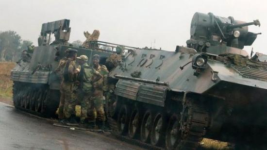 Armoured vehicles were seen taking up positions on roads outside Harare on Tuesday