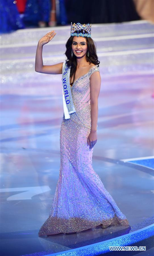 India's Manushi Chhillar waves as she is crowned at the 67th Miss World Competition in Sanya, south China's Hainan Province, Nov. 18, 2017. (Xinhua/Guo Cheng)