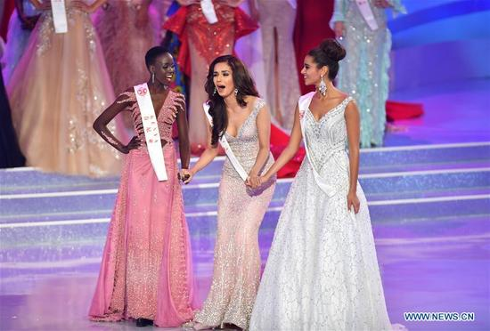 India's Manushi Chhillar (C) reacts as she is crowned at the 67th Miss World Competition in Sanya, south China's Hainan Province, Nov. 18, 2017. (Xinhua/Guo Cheng)