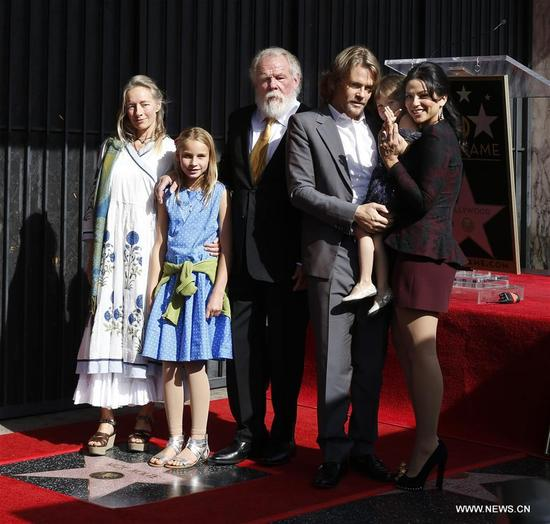Actor Nick Nolte poses for photos with his family during his star honoring ceremony on the Hollywood Walk of Fame in Los Angeles, the United States, Nov. 20, 2017. Nick Nolte was honored with a star on the Hollywood Walk of Fame on Monday. (Xinhua/Li Ying)