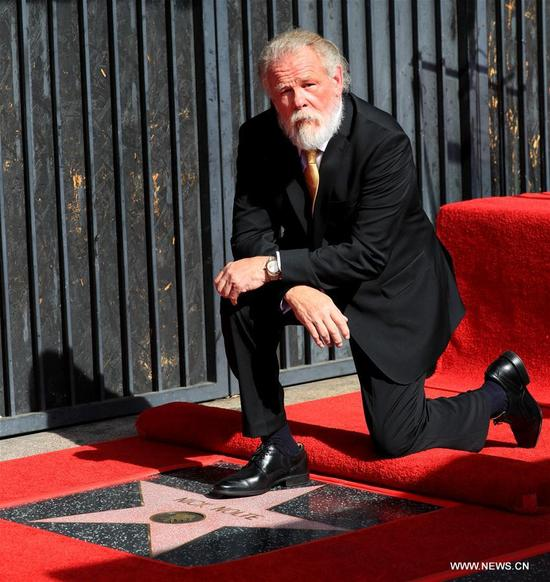 Actor Nick Nolte poses for photos with his star during his star honoring ceremony on the Hollywood Walk of Fame in Los Angeles, the United States, Nov. 20, 2017. Nick Nolte was honored with a star on the Hollywood Walk of Fame on Monday. (Xinhua/Li Ying