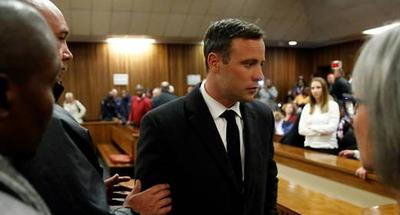 South African court doubles Pistorius sentence to more than 13 years