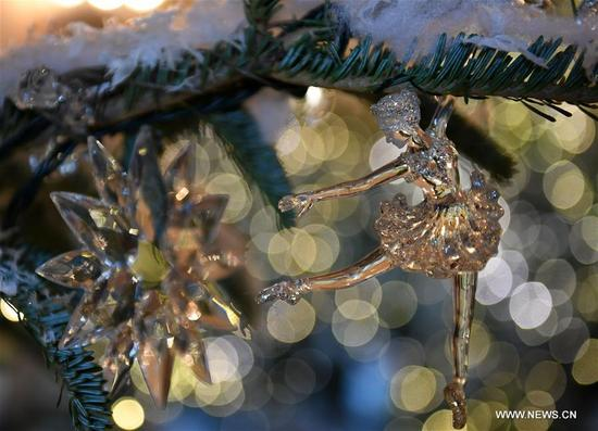 Christmas tree ornaments are seen during a media preview of the 2017 holiday decorations at the White House in Washington D.C., the United States, on Nov. 27, 2017. Some 150 volunteers from 29 states spent more than 1,600 hours to finish the decorations including 53 Christmas trees and more than 12,000 ornaments. An estimate of 25,000 visitors are expected to tour the White House for the Christmas holiday. (Xinhua/Yin Bogu)